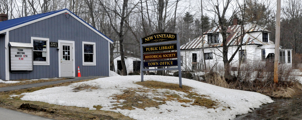 New Vineyard residents will be asked at Town Meeting to spend $15,000 to demolish the town-owned building, right, beside the Town Office on Lake Street in New Vineyard.