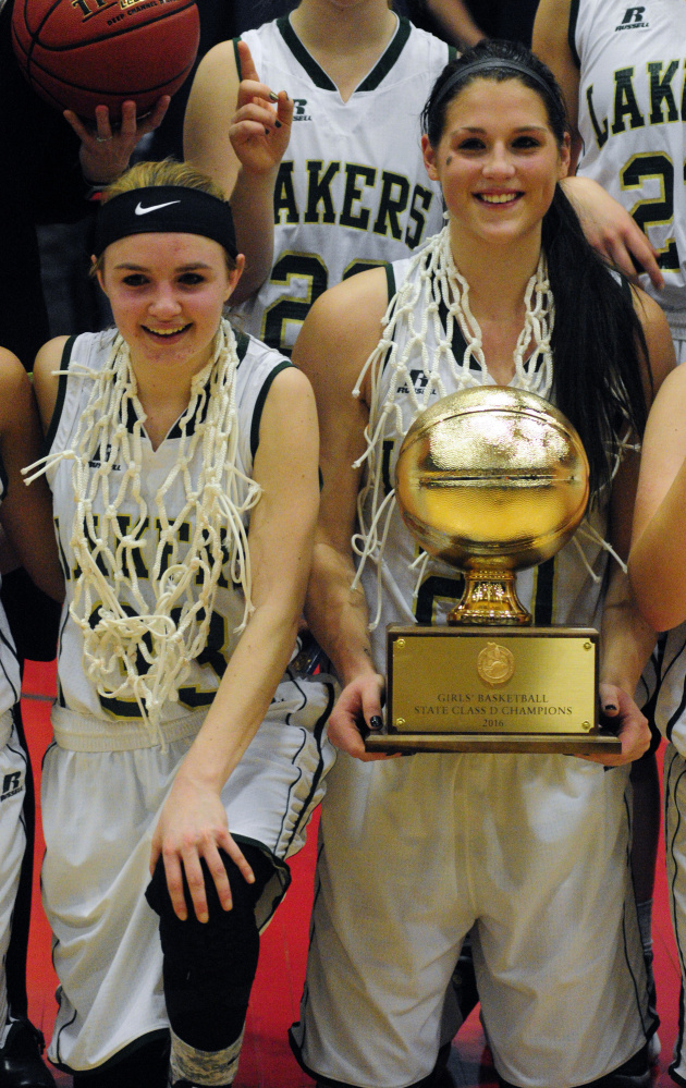 In this Feb. 27 photo, Rangeley captains Maddison Egan, left, and Blayke Morin are all smiles after winning the Class D girls basketball state championship at Augusta Civic Center. Morin scored 17 points on Saturday while playing for the South regional team in the Class C/D girls basketball all-star game in Bangor.
