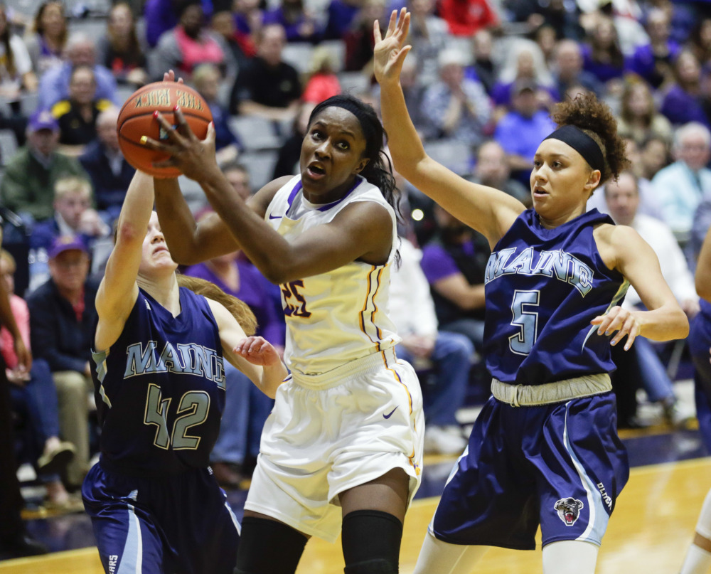 Albany forward Shereesha Richards (25), of Jamaica, works against Maine defenders Sigi Koizar (42) and Bella Swan (5) during the second half an NCAA college basketball game in the America East Conference women's tournament championship on Friday in Albany, N.Y. Albany won 59-58.