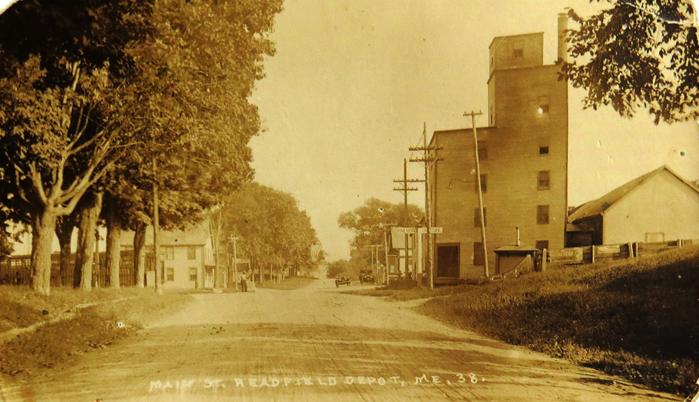 From 1849 until well into the 20th century several homes and businesses appeared at Readfield Depot. There was a school, the Smith Memorial Methodist Church, hotels, liveries and the train station on Main Street. Dominating this 1920s photo is Nelson Gordon's grain mill, elevator, sawmill and store. On the left can be seen part of the old William Luce Store that was later converted to a tenement house by Gordon.