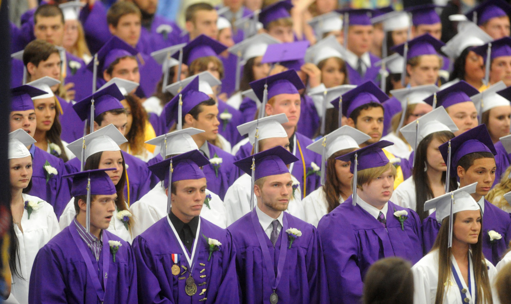 273acc5bfae Waterville Senior High School s class of 2014 sports purple gowns for boys  and white for girls