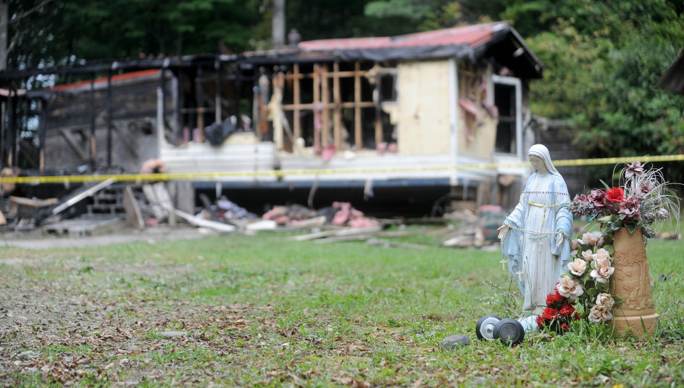 This mobile home at 289 Browns Corner Road in Canaan was destroyed by fire Sept. 21, 2015. This photo shows the charred remains on Sept. 22. It was the third fire in that town in three weeks. (Staff file photo by Michael G. Seamans)