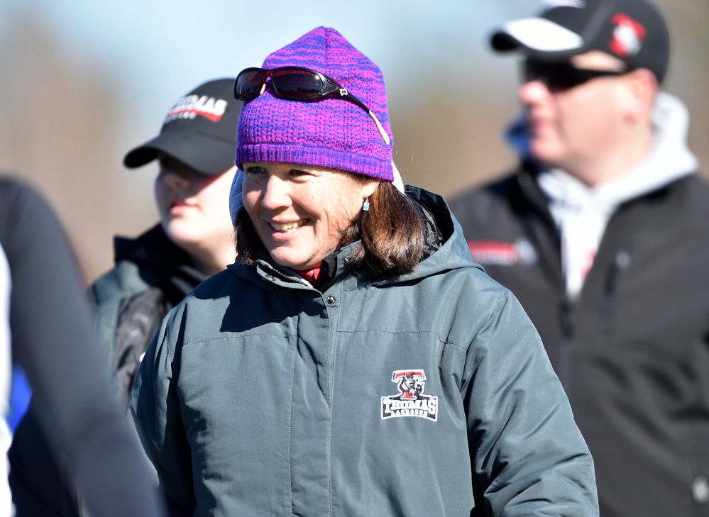 Thomas College women's lacrosse coach Deb Biche-Labbe smiles after a game against St. Joseph's on Saturday at Thomas College in Waterville.