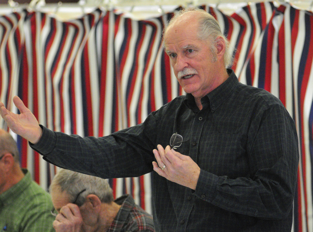Selectman Greg Couture answers a question during debate at the annual West Gardiner Town Meeting on Saturday in the West Gardiner fire station.
