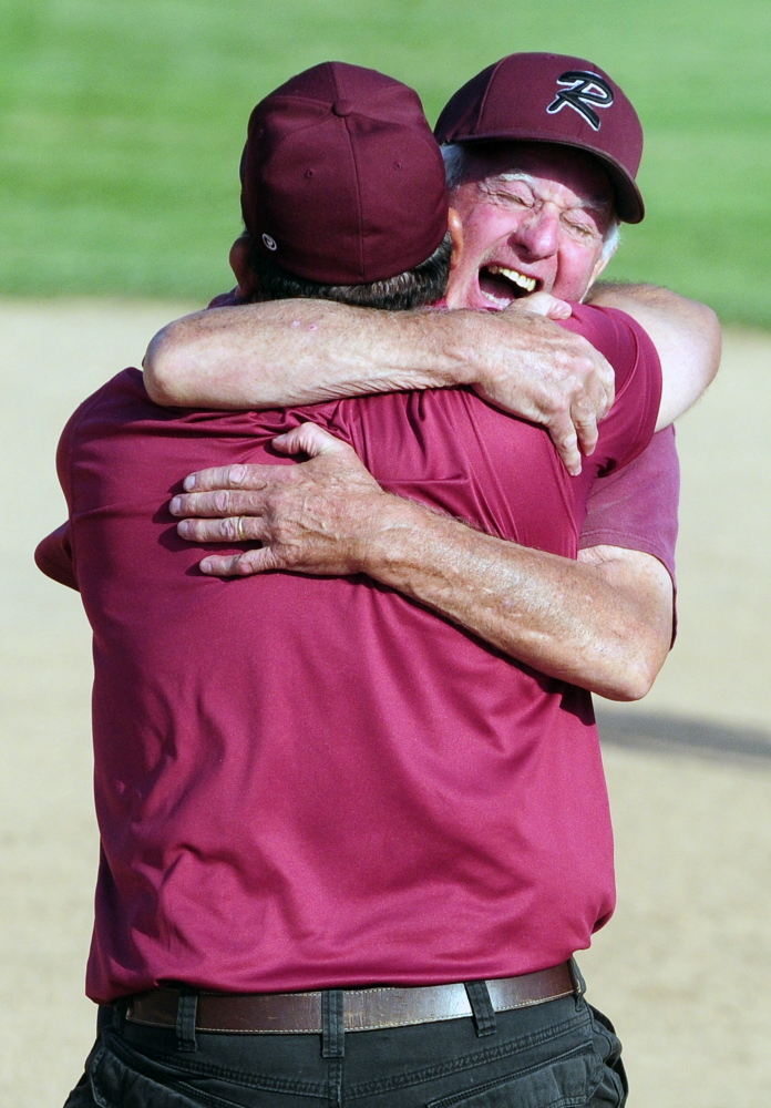 Richmond softball coach Rick Coughlin embraces Tony Martin after the Bobcats won the Class D state title last season. Coughlin recently resigned, citing health concerns.