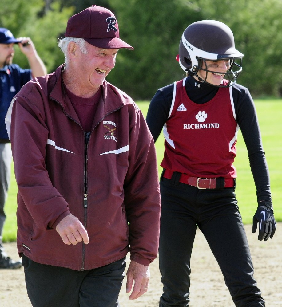 Richmond softball coach Rick Coughlin talks to Meranda Martin as she stands on third base during a 2014 game against Old Orchard Beach. Coughlin recently resigned, citing health concerns.