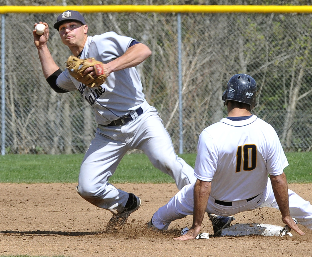 In this May 8, 2015 photo, USM's Sam Dexter makes the double play after getting out UMass-Dartmouth's Ryan Mederios at second during the Little East Conference winners' bracket final in Gorham.