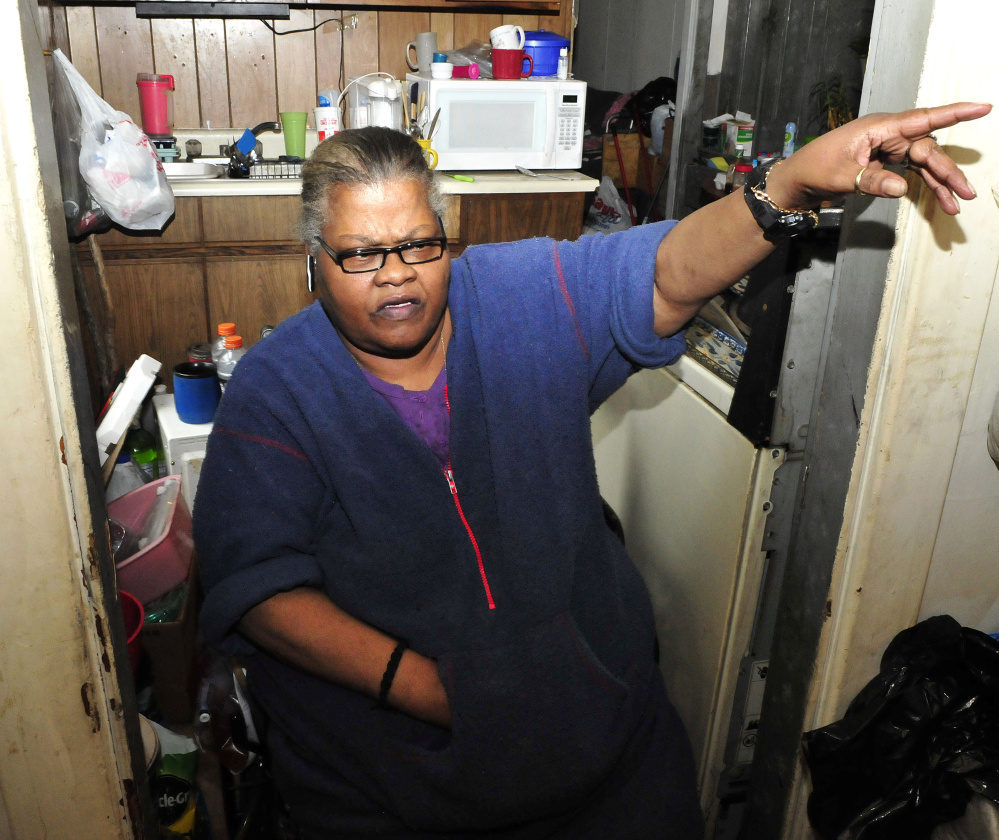 Janette Jones, a tenant at 58 Silver St. in Waterville, speaks Monday about the suspicious fire that damaged part of a lobby outside her apartment late Sunday.