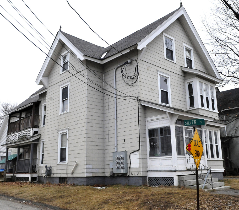 A fire that caused damage to this apartment building at 58 Silver St.t in Waterville late on Sunday was possibly set deliberately, police and fire officials said Monday. One five minutes earlier in a nearby pickup truck is also under investigation.