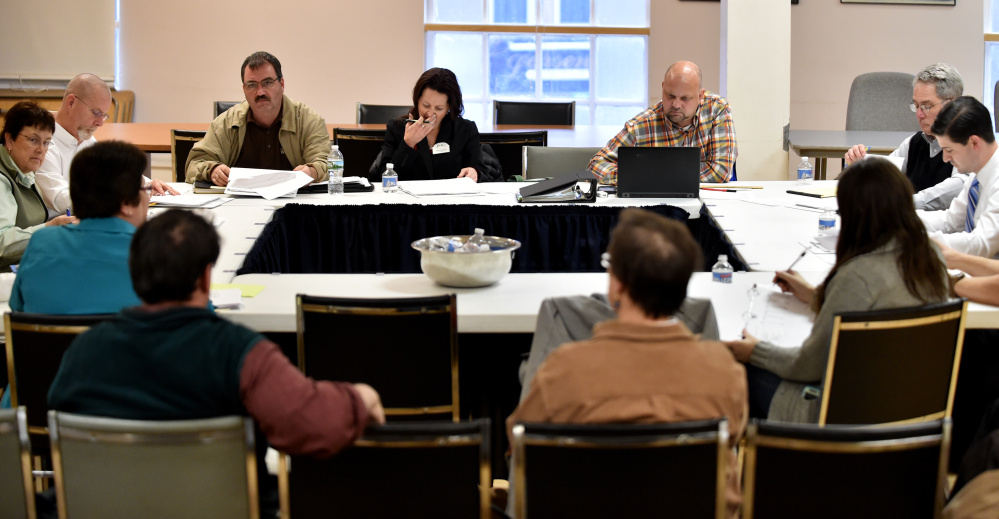 Waterville City Council members review budgets on Tuesday for information technology, health and welfare, planning, code enforcement, economic development and the Fire Department in the Council Chambers at City Hall in Waterville.