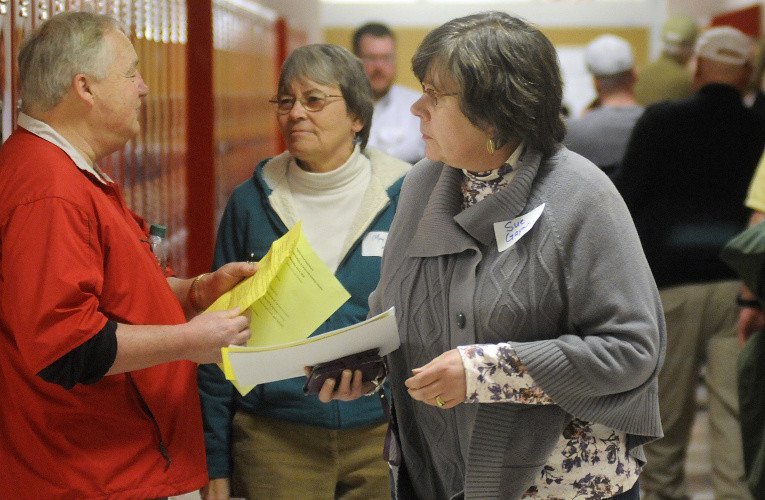 People walk to workshops during the opiate symposium at Cony High School in Augusta on Wednesday night.