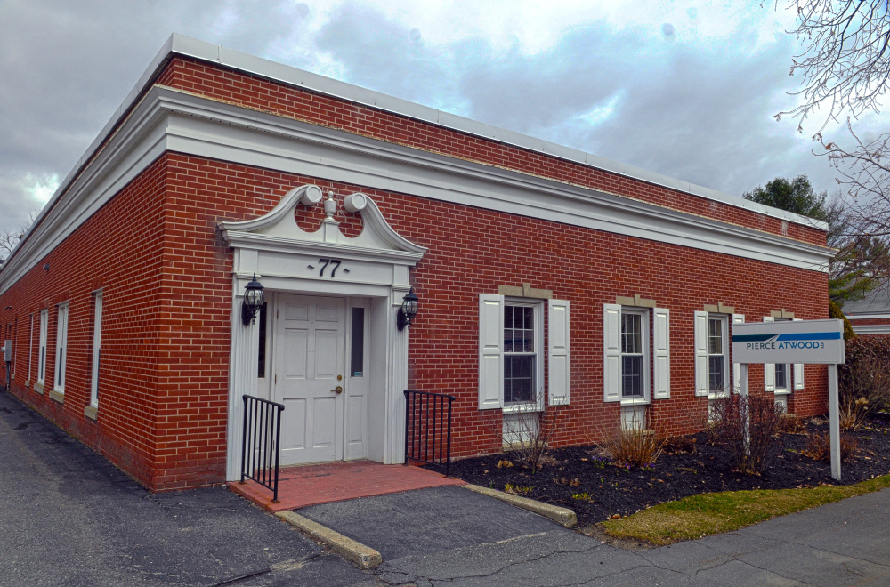Kennebec County officials closed Thursday on the purchase of 77 Winthrop St. in Augusta to house the Registry of Deeds.