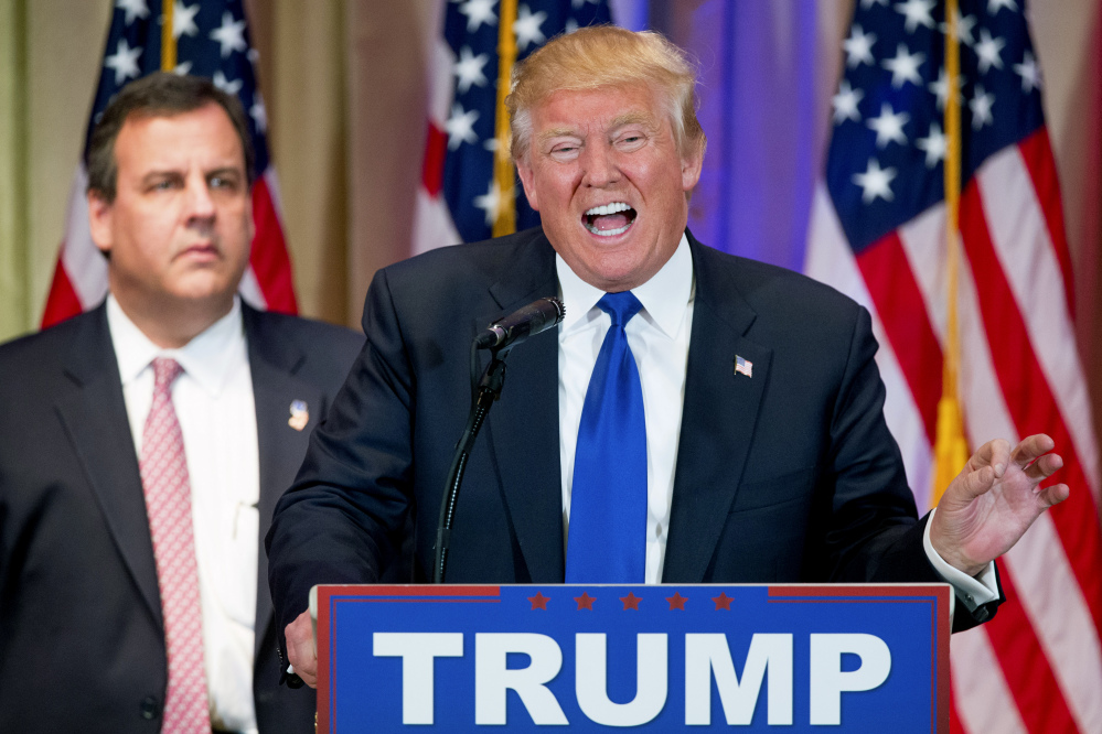 Republican presidential candidate Donald Trump, accompanied by New Jersey Gov. Chris Christie, speaks during a news conference on Super Tuesday primary election night at The Mar-A-Lago Club in Palm Beach, Fla.