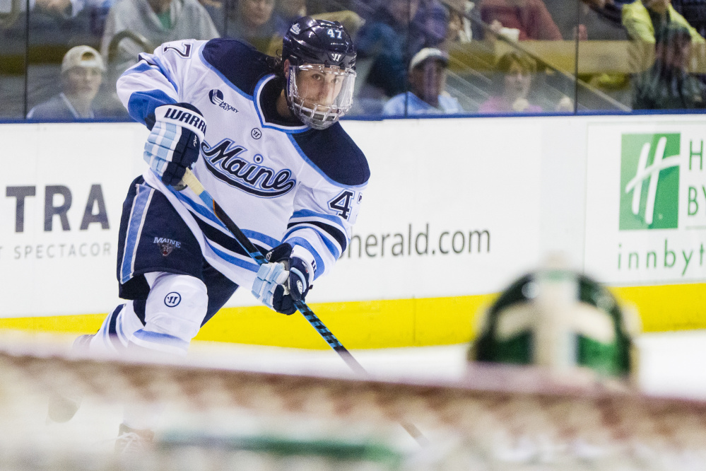 Ben McCanna/Staff Photographer UMaine forward Mark Hamilton shoots on Michigan State goaltender Jake Hildebrand. The Black Bears face Northeastern this weekend in a best-of-three series in the first round of the Hockey East Playoffs.