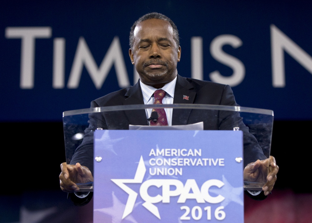 Ben Carson addresses the Conservative Political Action Conference (CPAC), Friday in National Harbor, Md. He is ending his presidential campaign.