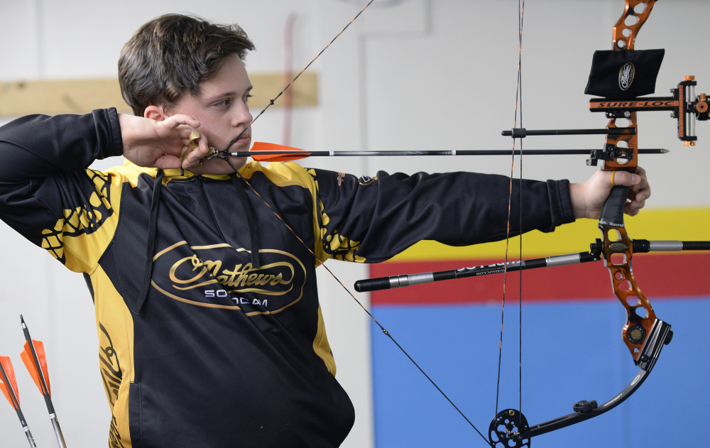 Malcolm Bourgeois, 13, of North Yarmouth takes aim at his target while practicing at Howell's Gun & Archery Center in Gray  on Wednesday.