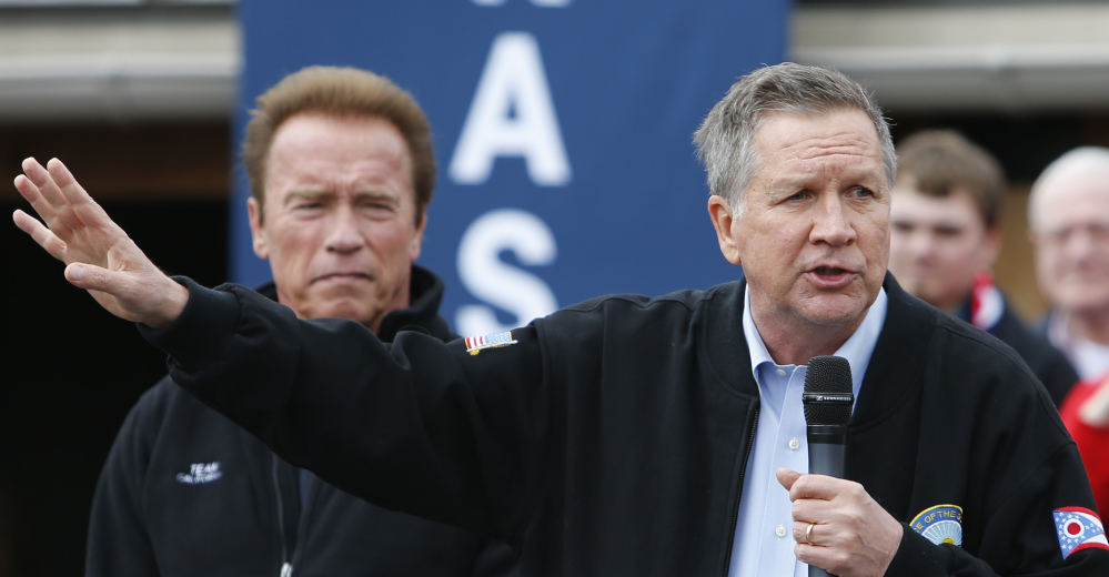 Ohio Gov. John Kasich addresses a rally on Sunday in Columbus, Ohio, where former California Gov. Arnold Schwarzenegger, left, endorsed him.