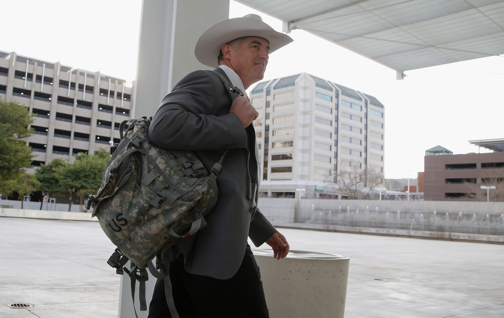 In this Jan. 28, 2016, file photo, Texas Ranger Nick Hanna, who was involved in the case against Warren Jeffs on the Fundamentalist Church of Jesus Christ of Latter Day Saints sect compound near San Angelo, Texas in 2008, arrives at the Sandra Day O'Connor U.S. District Court.