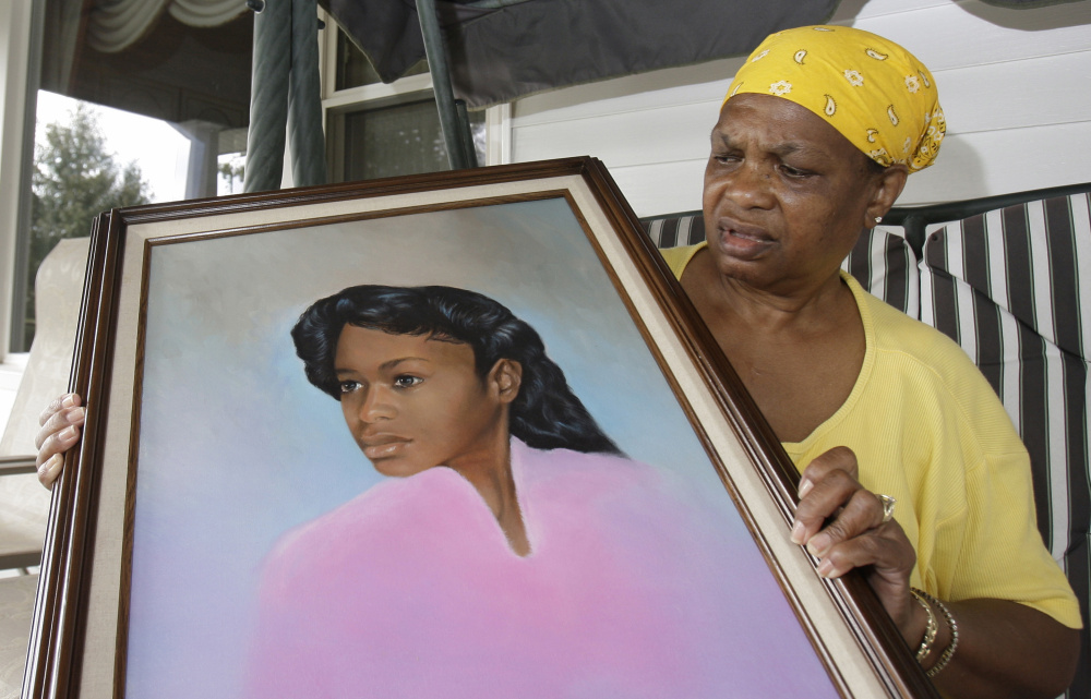 Bessye Middleton holds a painting of her daughter, Tryna, in Cleveland Heights, Ohio. Romell Broom faces execution for abducting, raping and killing the teen in 1984.