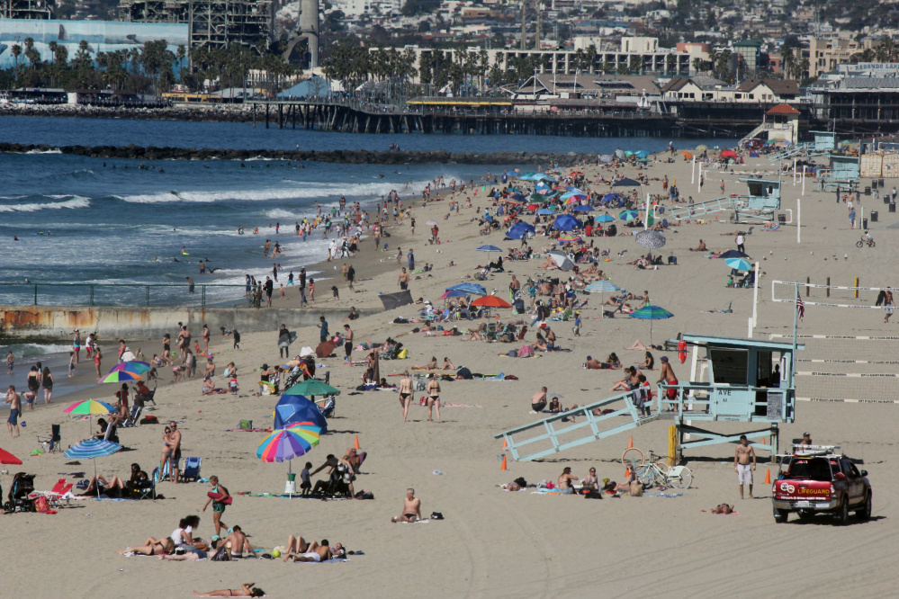 Swimmers and sunbathers gather at Redondo Beach, Calif., on Feb. 15 as Southern California baked in summerlike heat.