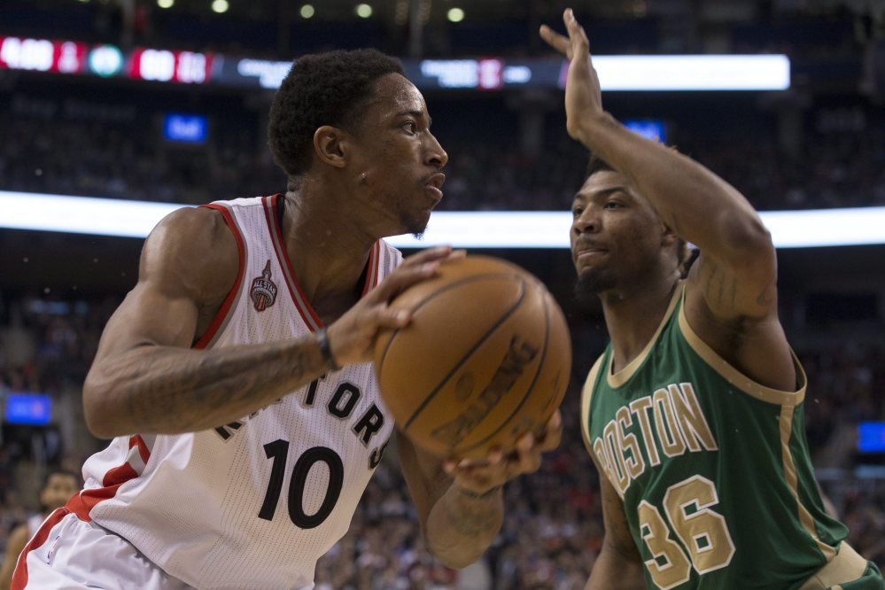 The Raptors' DeMar DeRozan drives against Boston's Marcus Smart in the second half of Friday night's game in Toronto.