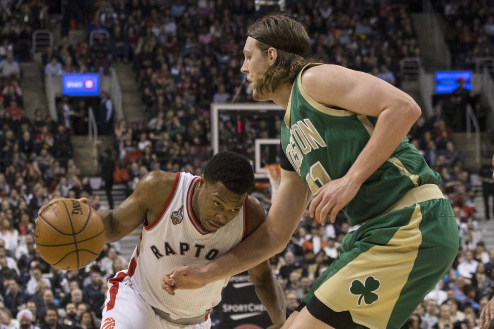 Toronto's Kyle Lowry drives against the Celtics' Kelly Olynyk in second half of Toronto's win. Lowry led the Raptors with 32 points, including 10 in a decisive stretch of the fourth quarter.
