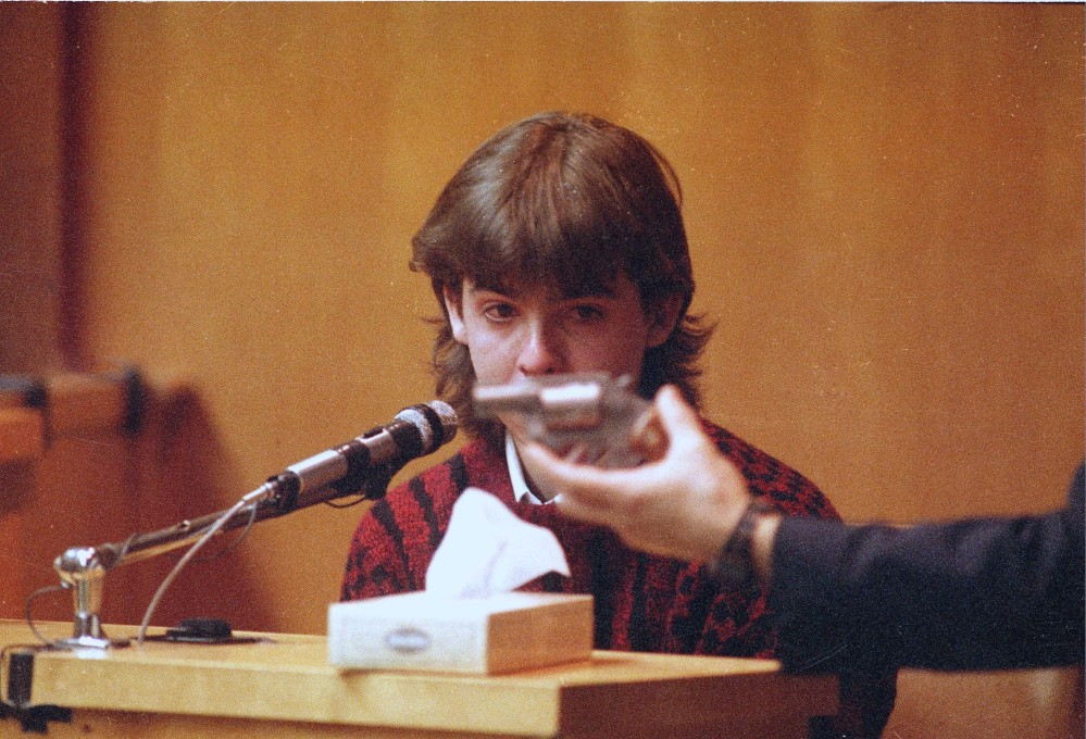 William Flynn is shown the gun he used to kill Gregory Smart at his trial in Rockingham County Superior Court in Exeter, N.H. A judge has ruled the gun used to kill Pamela Smart's husband in 1990 in a lurid case that inspired sensational media coverage will be returned to its owner.
