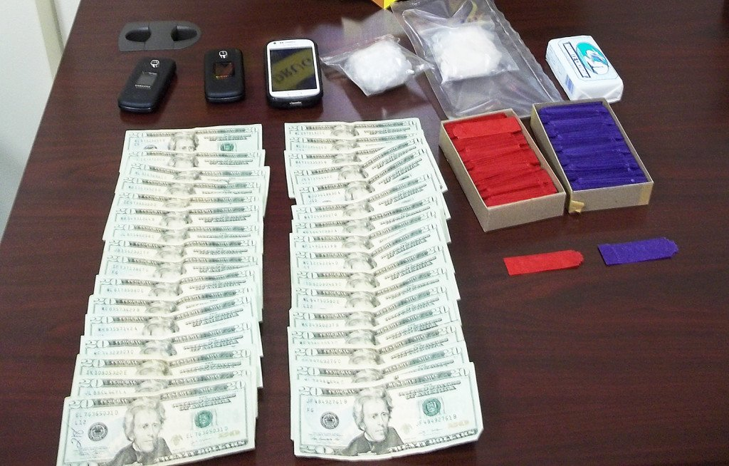 A stash of drugs and cash found by the The Maine Drug Enforcement Agency after the arrest of two men from Connecticut and New York in Houlton. Photo Courtesy of the Maine Drug Enforcement Agency