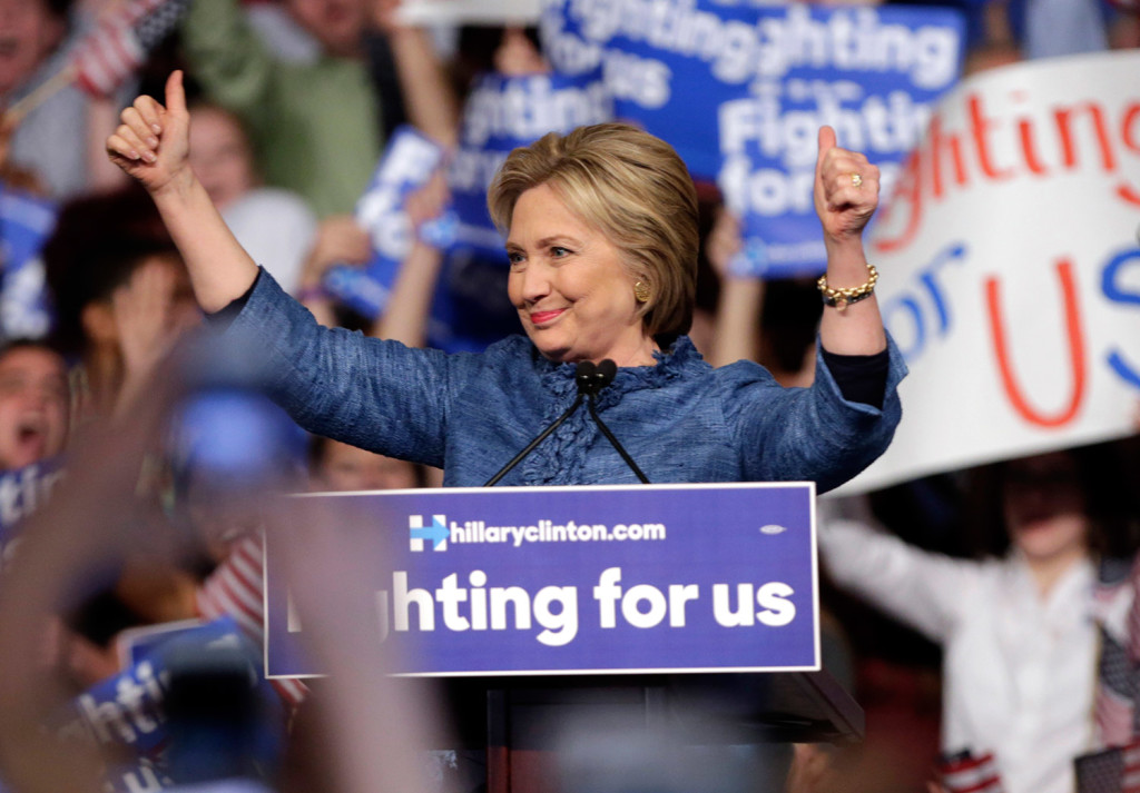 "Hillary Clinton arrives at her campaign rally Tuesday night in West Palm Beach, Fla. She said that with her primary wins Tuesday, ""We are moving closer to securing the Democratic Party nomination."""