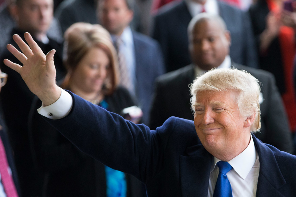Donald Trump waves to supporters at a campaign stop at the Port-Columbus International Airport in Columbus, Ohio, on Tuesday. In recent days, the New York businessman easily fended off a frantic, last-minute push from Republican Party stalwarts like 2012 presidential nominee Mitt Romney to thwart his success.