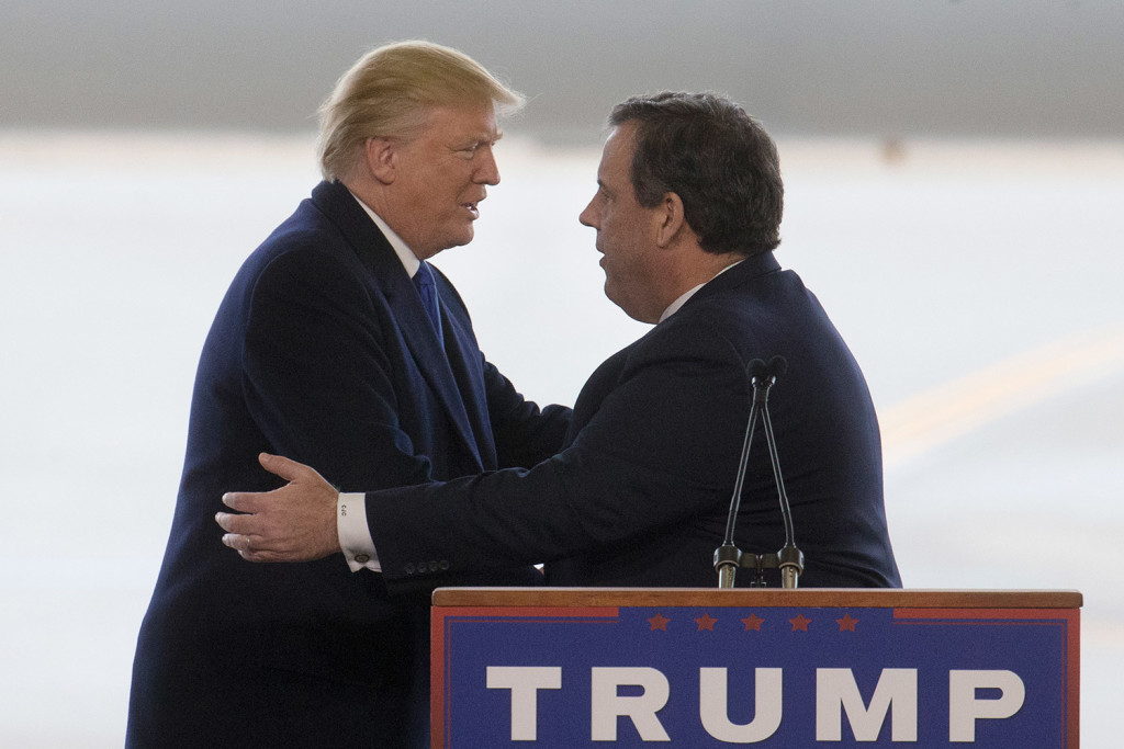 Donald Trump embraces New Jersey Gov. Chris Christie, a former candidate, after being introduced at a campaign stop in Columbus, Ohio, on Tuesday.
