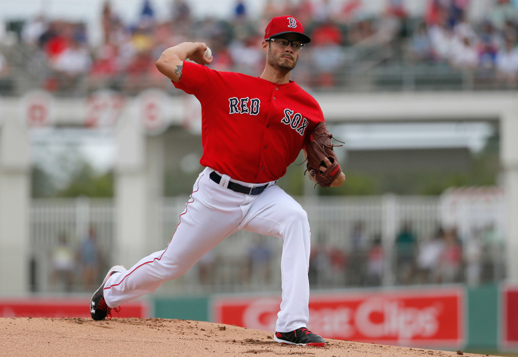 Joe Kelly works against the New York Mets in the first inning of Thursday's game in Fort Myers, Fla. Kelly  allowed just one run on five hits in seven innings. The Associated Press