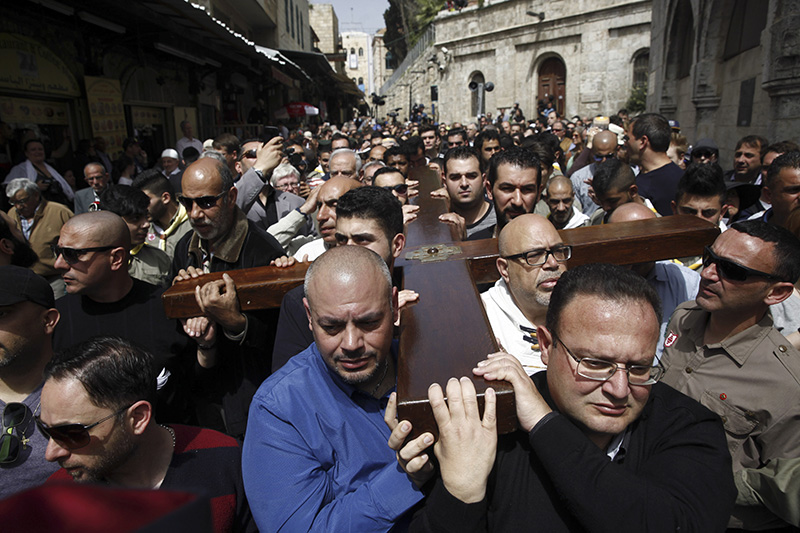 Catholics and Protestants commemorated the crucifixion of Jesus Christ by following the path in Jerusalem's Old City where, according to tradition, he walked on the way to the cross.