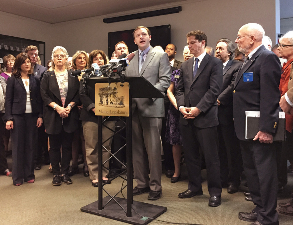 House Speaker Mark Eves of North Berwick is surrounded by members of the Maine House and Senate Democratic caucus on Thursday as the lawmakers announce a series of proposed changes to Maine's welfare laws.