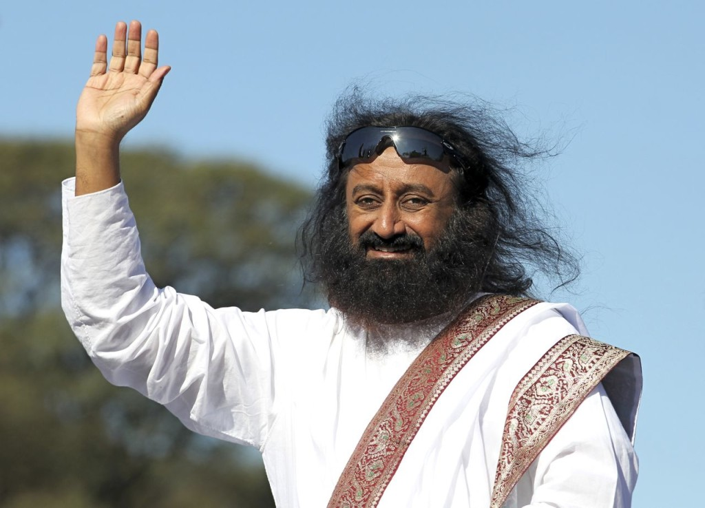 Hindu spiritual leader Sri Sri Ravi Shankar acknowledges his followers before an open-air meditation day organized by the Art of Living foundation in Buenos Aires in this 2012 photo. Reuters