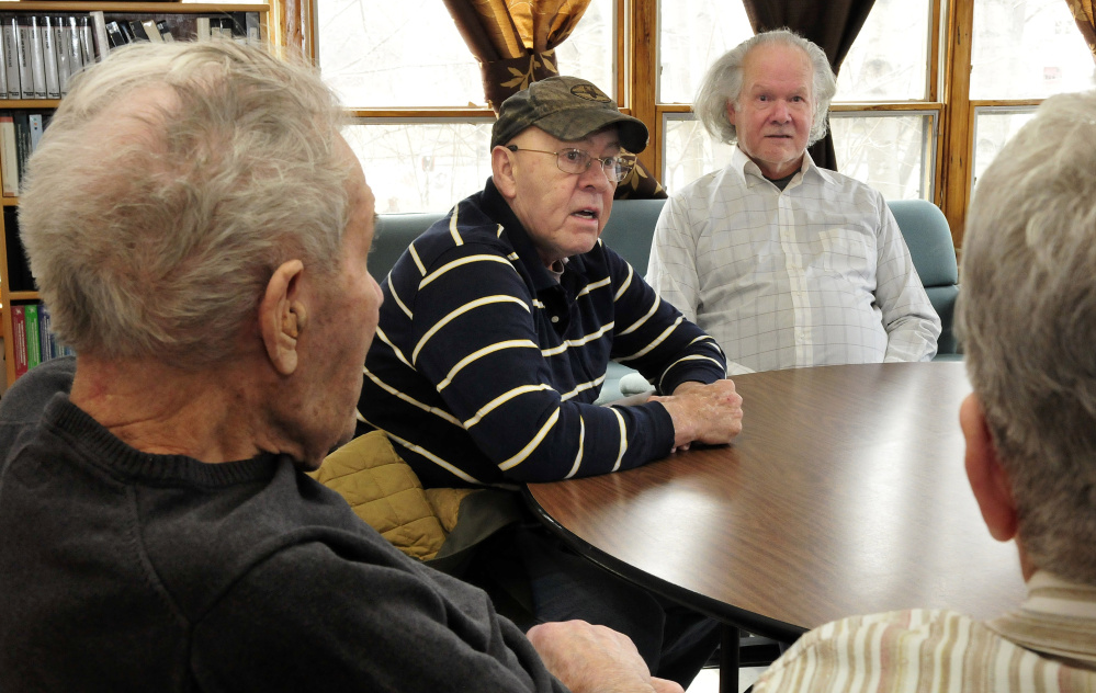 Beecher Ladd, left, listens as his sons Phil, center, and Wayne and daughter-in-law Marilyn talk about Beecher Ladd's 77-year marriage to his late wife, Ginny.