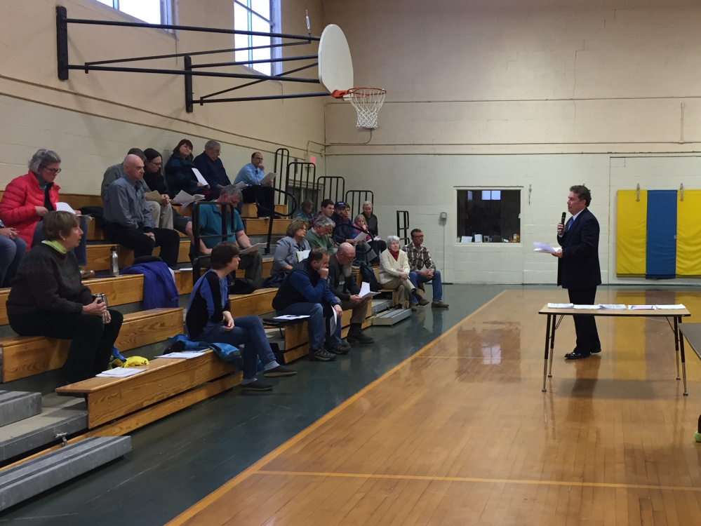 RSU 9 Superintendent Tom Ward addresses a gathering of some 30 people at an informational meeting on the school budget at Academy Hill School on Monday.