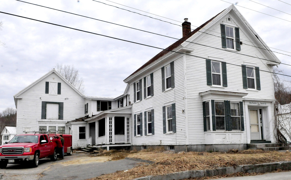 The apartment house at 112 Church St. in Farmington will be torn down and replaced with a municipal parking lot.