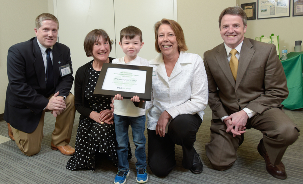 Hunter Norwood, 5, of Manchester, was presented a 2016 eco-Excellence Award March 23 during a 2016 ecomaine eco-Excellence Awards in Portland. From left, are Jim Gailey, chairman of ecomaine's board of directors and city manager for the City of South Portland; Karen Toothaker of Manchester Elementary School; Hunter Norwood, Barbara Galouch of Manchester Elementary School, who nominated Hunter for this award; and Kevin Roche, CEO of ecomaine.