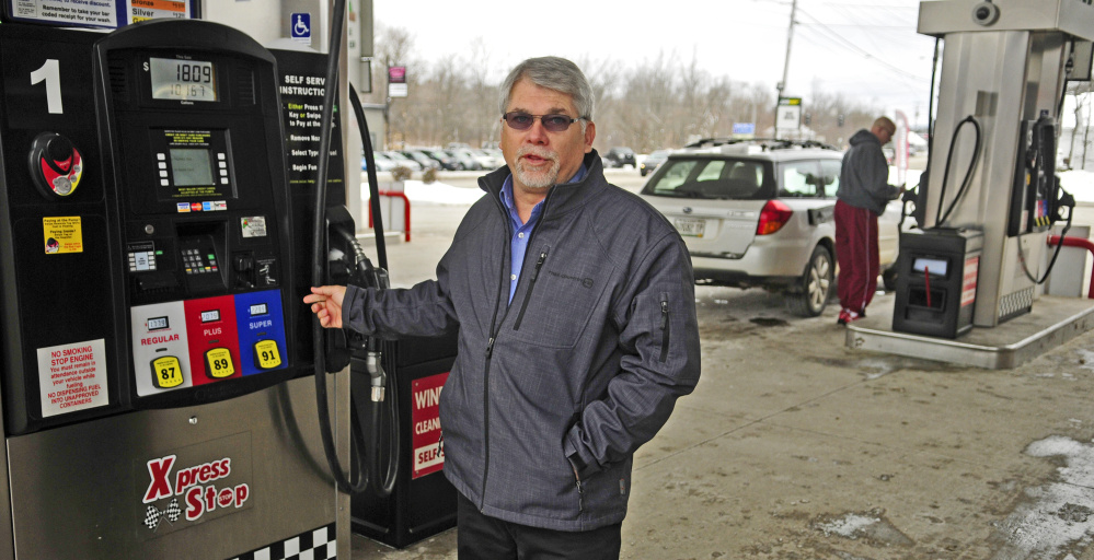 John Babb, president of J&S Oil, talks about converting the credit and debit card system to chip system during an interview on Feb. 10 at the company's Xpress Stop store in Manchester.