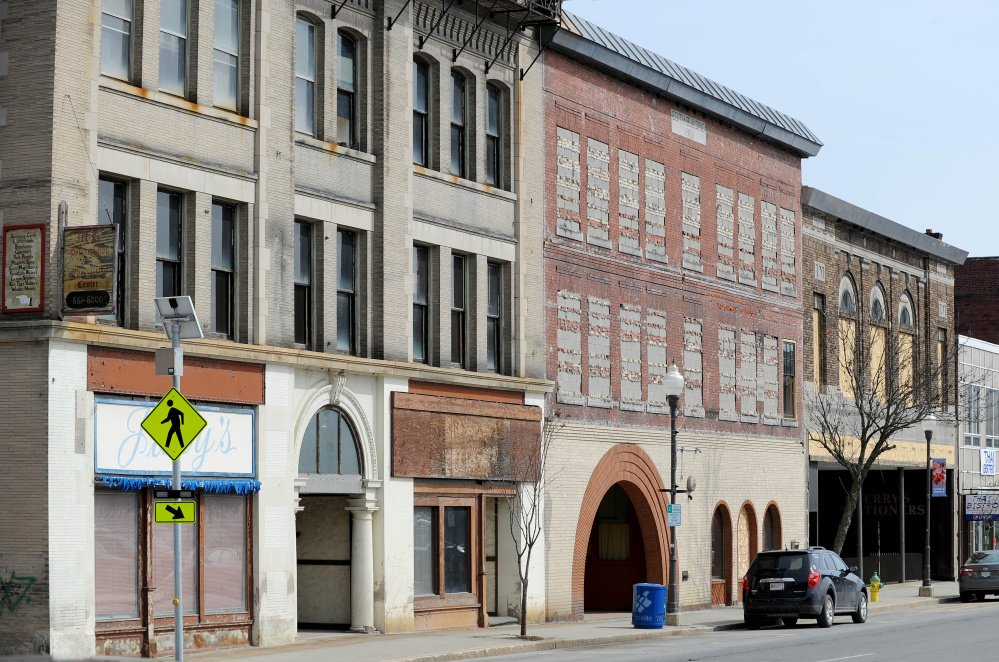 The Hains Building, left, and former Atkins Printing buildings are seen Wednesday on Main Street in downtown Waterville.