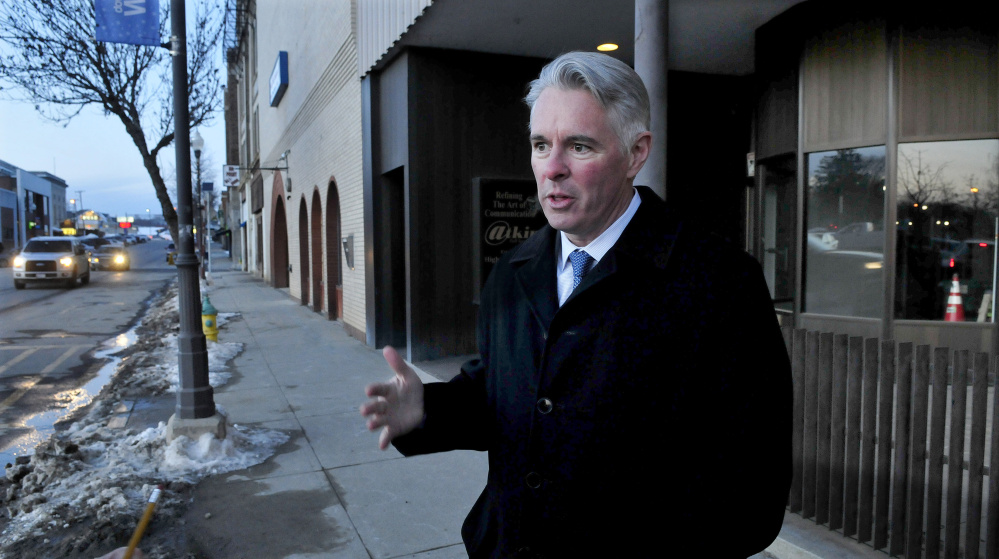 Colby College President David Greene, seen in January on Main Street in downtown Waterville, said this week the college is moving ahead with downtown development plans, including hiring a director of commercial development.