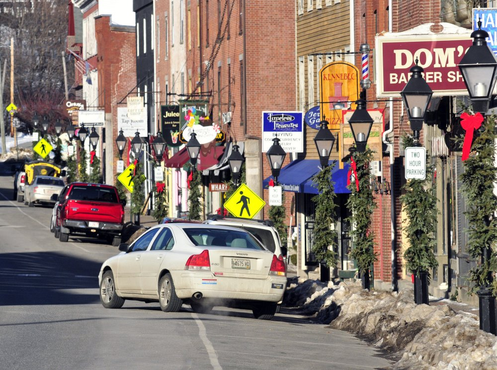 A car pulls out of a parking spot on Jan. 5 along Water Street in Hallowell, where a major reconstruction project is set for 2018.