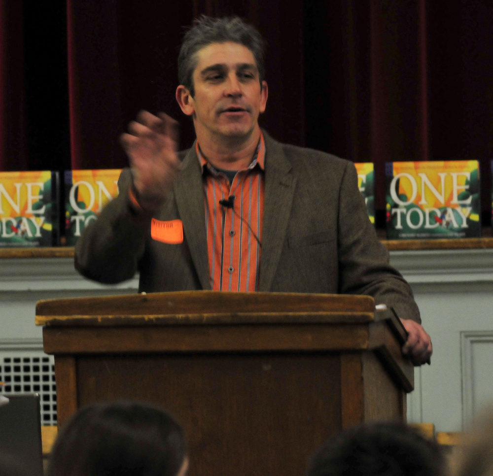 Poet Richard Blanco, who will be at the University of Maine at Augusta on Saturday, speaks in December 2015 to students at Winslow Junior High School.