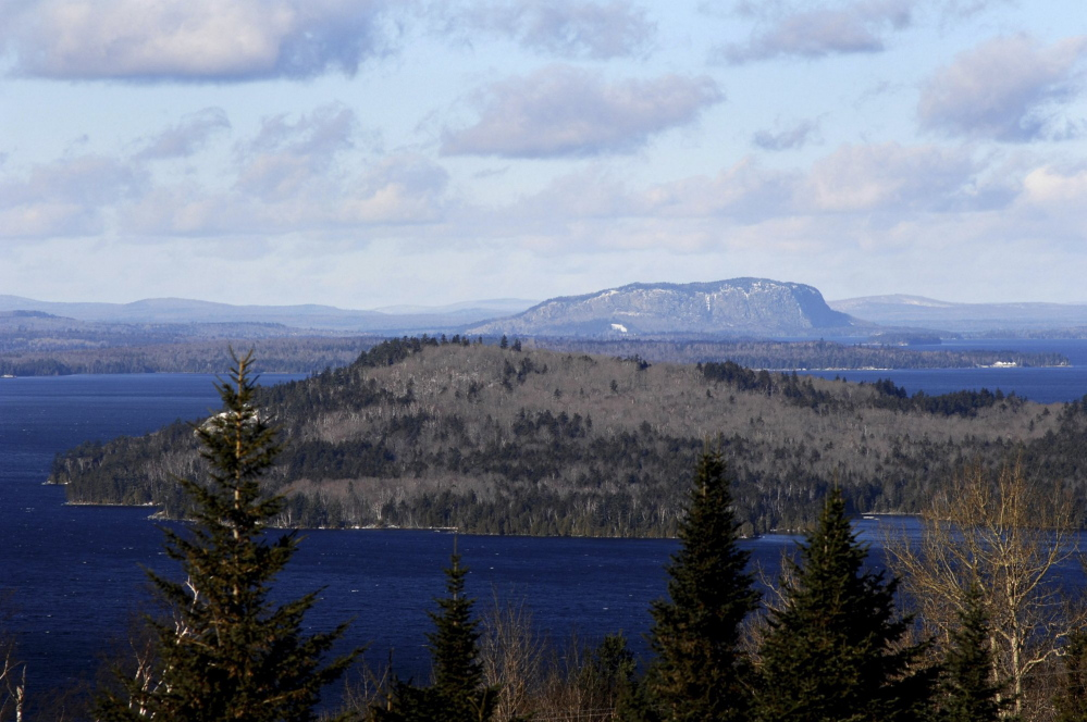 Moosehead Lake's iconic Mount Kineo rises over the lake. The Moosehead Region Futures Committee is expressing concern that energy company SunEdison might file for bankruptcy and says it is committed to defeating plans the company has to build a 26-turbine wind farm in Misery Ridge.