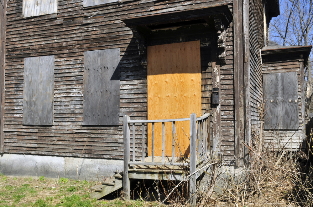 A house at 5 Patterson St. in Augusta, shown Tuesday, would be out of compliance with a proposed property maintenance ordinance, which, among other things, would prohibit boarding up windows.