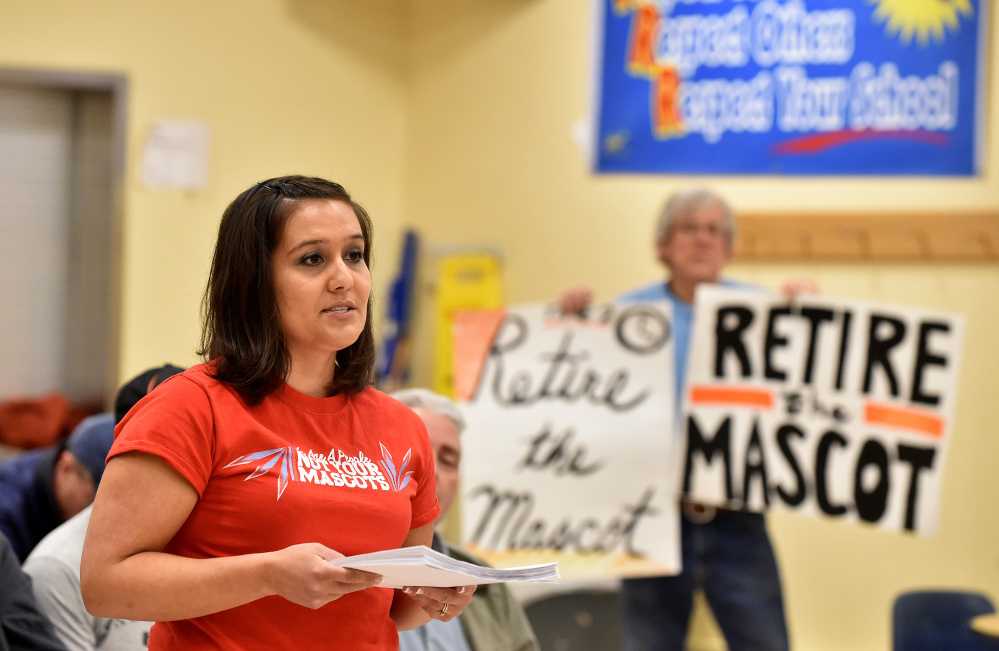 Maulian Smith offers words to the Skowhegan school board before presenting them with a petition to change the Skowhegan Area High School Indians mascot during a meeting at Skowhegan Middle School on Thursday.