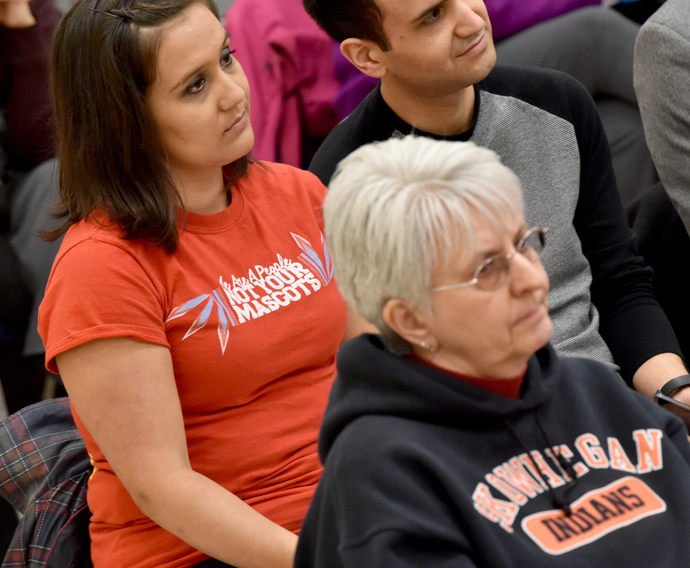 """Maulian Smith of """"Not Your Mascot Maine"""" sits with a shirt that reads """"We Are A People Not Your Mascots"""" during a school board meeting at Skowhegan Middle School on Thursday."""