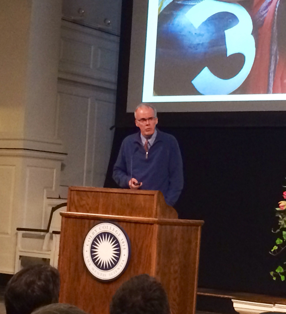 Author and environmentlist Bill McKibben, founder of the grass-roots climate change group 350.org, urges an audience on Thursday night at Colby College to fight the swift-moving affects of climate change.