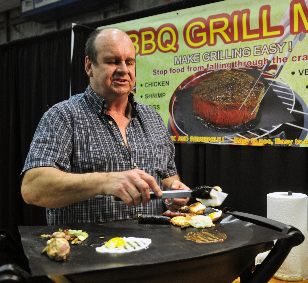 Duane Blous, of Another Look, demonstrates grill mats Friday during the 43rd annual Manchester Lions Club Home and Garden Show at the Augusta Civic Center.